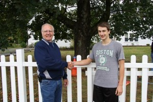 Chair of the Southborough Council on Aging Bill Harrington thanks Thomas Cimino for all his hard work while standing in front of the new fence.