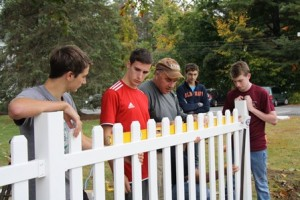 Thomas Cimino, Alex Schroeder, Committee Chair Peter Kachajian, Bobby Raps, and Dillon Ford of Troop 92 Southborough spent their Saturday completing the new fence outside the Southborough Senior Center Oct 5.