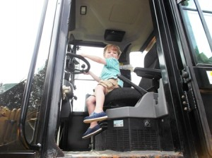 Nick, 3, pretends to drive a truck at the Southborough Public Library's