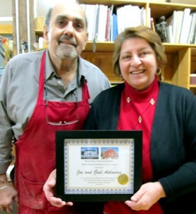 Joe and Gail Aslanian proudly display the Shrewsbury Historical Society Preservation and Restoration Award for their work in renovating a late 1700's New England barn.