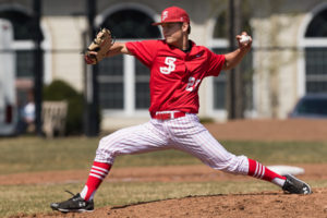 St. John's starting pitcher Jared Wetherbee winds up to throw a pitch.