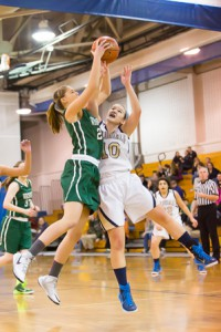Wachusett's Mackenzie White (left) and Shrewsbury's Alexa Deraney (right) leap up to grab a rebound.