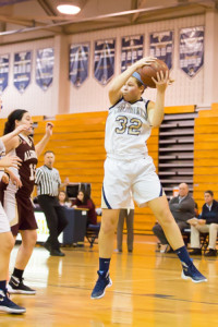 Shrewsbury's Kate Montigny (#32) goes up to grab a rebound in a game against Algonquin
