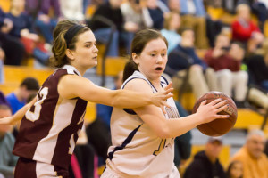 Shrewsbury's Janey Mullins (#12, white) keeps the ball away from Algonquin's Maddie Collins (#13)