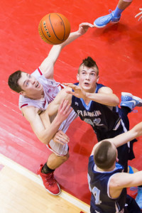 St. John's Cole Stairs and Franklin's Connor Peterson look up as they try to grab a loose ball.
