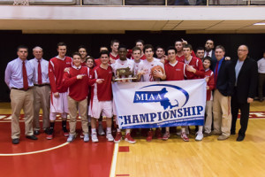 St. John's varsity basketball team with their Central Division 1 championship trophy.