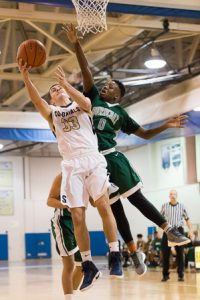 Burncoat's Travon Williams attempts to block a shot by Shrewsbury's Michael Filiere.