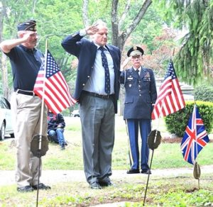 """Saluting as """"The Last Post"""" is played are (l to r) Commander Fred Russell of the Victor Quaranta American Legion Post 397, President Richard Schofield of the British Officers Club of New England, and member Thomas Vantre."""