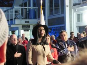Lois Dwira sings the national anthem.
