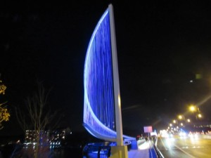 Sails honor the lake's legacy of rowing and crew.