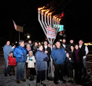 A crowd of approximately 40 attends the menorah lighting.
