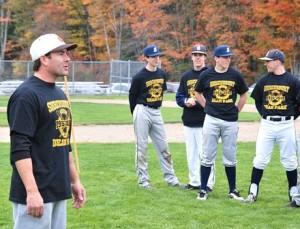 Craig Colonero, volunteer coach, offers a pep talk to Dean Park teammates comprised of Shrewsbury High School students.