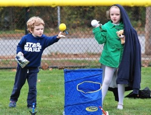 Charles Parmenter, 4, and his sister Amelia, 6, play lawn games after the Dean Park rededication.