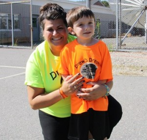 Kathryn Christo, Drew's cousin, poses with Zach Papper, 6, of Shrewsbury. Zach and Drew were friends who met at Gymboree.