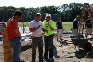 Scott Selmecki, general manager of Shrewsbury Home Depot; Joe Coveno,  a foreman at Childscapes and Jennifer Vangel, a teacher at Parker Road Preschool, go over plans at the site.