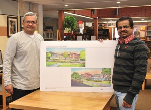 Vinay Vyas and Arumugham Raghunathan display the architect drawing of the remodeled Shrewsbury Public Library. Photo/Ed Karvoski Jr.