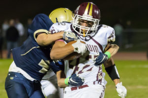 Algonquin's Max Cerasoli tries to break away as he is grabbed by several Shrewsbury defenders.
