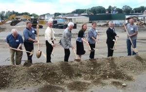 Members of the town's Planning Board participate with Grossman officials in the ground breaking.