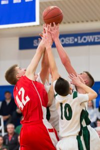 St. John's Ben Sanfratello and a host of Wachusett players vie for a rebound.