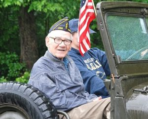 Art Dobson, U.S. Marine Corps veteran in the Korean War, rides in an antique military jeep. Photo/Ed Karvoski Jr.