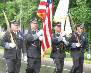 The color guard of the Shrewsbury Police Department leads the parade. Photo/Ed Karvoski Jr.