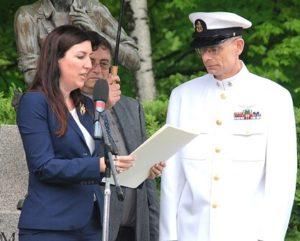 State Rep Hannah Kane presents a citation to retired Senior Chief Petty Officer Christopher Knight. Photo/Ed Karvoski Jr.