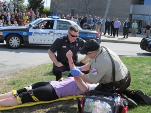 First responders prepare a student to be transported to the hospital.
