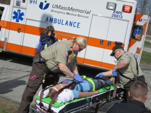 First responders help an injured student.