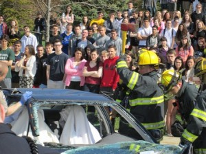Students watch as first responders prepare to rescue trapped passengers.