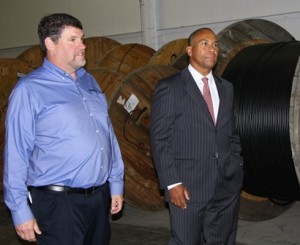 President and CEO of Phoenix Communications Mark Langevin gives Gov. Deval Patrick a tour of the company's new Shrewsbury location.