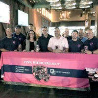 Members of the Patrol Officers Union NEPBA Local 191 with 15-40 Connection's Helene Winn and David Faucher (in pink) Photo/Melanie Petrucci