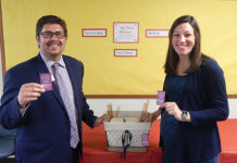 Matthew J. Armenti from UniBank's Officer/Relationship Branch Manager (l) and Tiffany Ostrander, Coolidge School Principal Photo/Melanie Petrucci