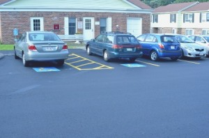 Newly paved handicap parking in front of one of the common buildings