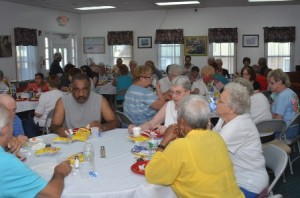 Residents enjoying the cookout inside on a stifling July day.