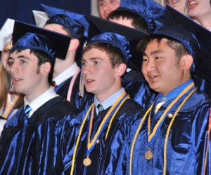 (l to r) Cam Wade, Will Shipman and Anthony Chan sing with the SHS Choir.