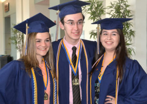 A classmate photographs (l to r) Lena Karp, Zach Fuller and Jacqueline Leo.