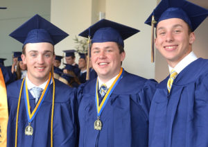 Gathered prior to graduating are (l to r) Adam Knight, Eric Pitney and Cam Schaefer.