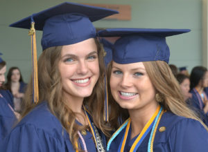 Olivia Meuse and Hannah Dugan await their graduation ceremony together