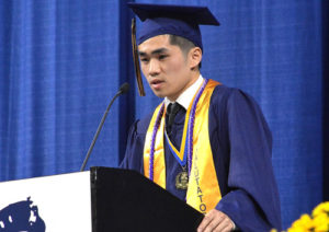 Salutatorian Ian Chandra advises classmates to step outside of their comfort zone.