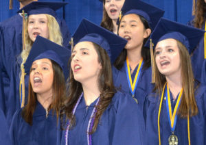 Singing with the Senior Choir are (front, l to r) Olivia Schultz, Paige Lucier, Angie Rezuke, (back) McKenna Katz and Lu Yang.