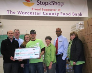 Jean McMurray, executive director, Worcester County Food Bank, fifth from left, with Stop and Shop employees (l to r) Bekim Krasniqi, John Costello, Cheryl Cedrone, Drew Deboise, Daryl Peterson and Beverly Doonan Photo/David Bagdon