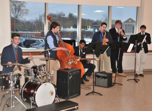 The St. John's High School Jazz Combo performs as guests mingle during the silent auction.