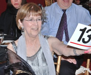 Helen McLaughlin bids $2,600 and wins two tickets to a New England Patriots game.