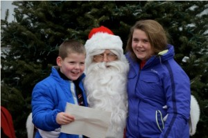 Ryan Lambert, 8, and his sister Megan, 11,    share their Christmas wishes with Santa.