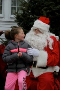 Madison, 7, Santa share a special moment.
