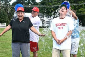 Parks and Recreation Director Angela Snell and Little League coach John Biscotti get soaked. Photos/Ed Karvoski Jr.
