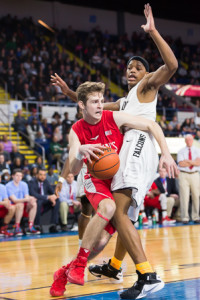 – St. John's senior Joseph Murphy powers his way towards the basket.