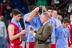 - St. John's players receive their championship game medals in a post-game ceremony.