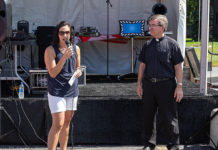 Beth Casavant, representing the Shrewsbury Board of Selectmen, and Msgr. Michael Rose of St Mary's Parish, welcome all to the Family Festival. Photos/Jerry Callaghan
