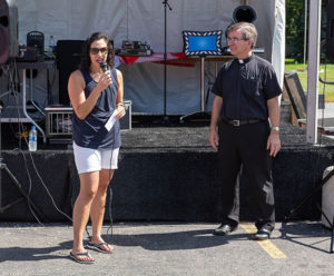 Beth Casavant, representing the Shrewsbury Board of Selectmen, and Msgr. Michael Rose of St Mary's Parish, welcome all to the Family Festival.Photos/Jerry Callaghan